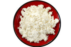Cottage cheese. On red plate Stock Image