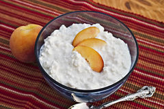Cottage cheese. Bowl of cottage cheese and fresh peaches Stock Photo