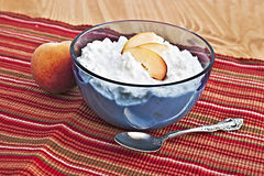 Cottage cheese. Bowl of cottage cheese and fresh peaches Royalty Free Stock Images