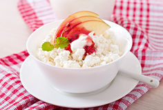 Cottage cheese with apple, berry syrup and sour cream Stock Photography