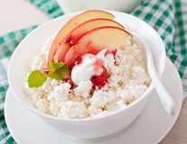 Cottage cheese with apple, berry syrup and sour cream Royalty Free Stock Photos