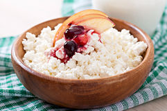 Cottage cheese with apple, berry syrup and sour cream Stock Photo