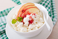 Cottage cheese with apple, berry syrup and sour cream Stock Image