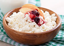 Cottage cheese with apple, berry syrup and sour cream Stock Photos