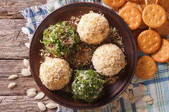 Cottage cheese balls with crackers, herbs and pumpkin seeds clos Royalty Free Stock Photo