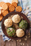 Cottage cheese balls with crackers, herbs and pumpkin seeds clos Stock Image