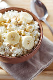 Cottage cheese with banana and nuts Stock Photo