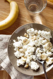Cottage cheese with banana and nuts Royalty Free Stock Images