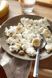 Cottage cheese with banana and nuts Stock Photography