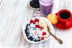Cottage cheese with berries, smoothies and coffee for breakfast. Cottage cheese with blueberries, raspberries and yogurt, blueberry smoothie and cup of coffee Stock Photo
