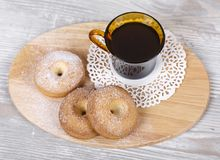Cottage cheese biscuits and coffee. Tvotozhnoe ring-shaped cookies and hot coffee on a napkin Royalty Free Stock Image