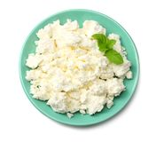 Cottage cheese in blue bowl isolated on white background top view stock photos