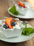 Cottage cheese with blueberries and caramelized peaches Stock Photos