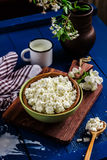 Cottage cheese in a bowl on blue wooden table Royalty Free Stock Image