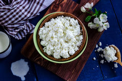 Cottage cheese in a bowl on blue wooden table Royalty Free Stock Photography