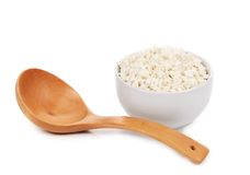 Cottage cheese in bowl with spoon. Royalty Free Stock Images