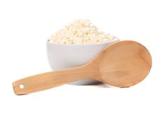 Cottage cheese in bowl with spoon. Stock Image