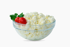 Cottage cheese  in a bowl on white. Cottage cheese in a glass bowl, isolated on white background royalty free stock image
