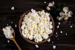 Cottage cheese in a bowl on wooden table. Style rustic. Royalty Free Stock Photo