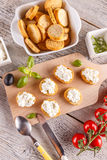 Cottage cheese on bruschetta Stock Images