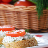 Cottage cheese bruschettas and vegetable basket Royalty Free Stock Photo