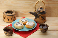 Cottage cheese cakes  with jam on blue plate and tea set Stock Image