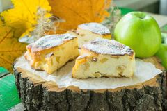 Sweet casserole of homemade cottage cheese with apples. Rustik style royalty free stock images