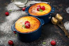 Cottage cheese casserole with cherries. On dark table Royalty Free Stock Photo
