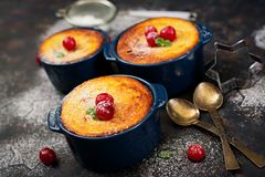 Cottage cheese casserole with cherries. On dark table Royalty Free Stock Image