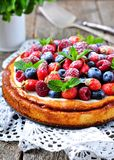 Cottage cheese casserole with fresh strawberries, blueberries, raspberries and mint and powdered sugar. Dinner Royalty Free Stock Images