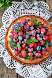 Cottage cheese casserole with fresh strawberries, blueberries, raspberries and mint and powdered sugar. Dinner Royalty Free Stock Image