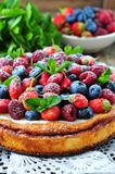 Cottage cheese casserole with fresh strawberries, blueberries, raspberries and mint and powdered sugar. Dinner Royalty Free Stock Photography