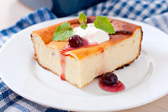 Cottage cheese casserole on white plate Royalty Free Stock Image