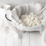 Cottage cheese in cheesecloth Royalty Free Stock Image