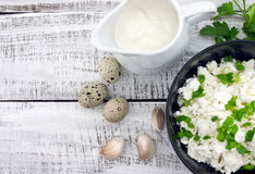 Cottage cheese with chives in black ceramic bowl on rustic woode. N background. Healthy breakfast. Healthy food concept. Top view Stock Image