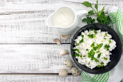 Cottage cheese with chives in black ceramic bowl on rustic woode. N background. Healthy breakfast. Healthy food concept. Top view Royalty Free Stock Photography