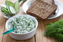 Cottage cheese with chives, garlic and dill Royalty Free Stock Photo