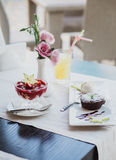 Cottage cheese and chocolate desserts with ice-cream and fruit Royalty Free Stock Image