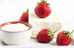Cottage cheese with cream and strawberries Royalty Free Stock Images