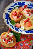 Cottage cheese cream tarts with berries and fruits Royalty Free Stock Image