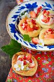 Cottage cheese cream tarts with berries and fruits Stock Photography