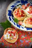 Cottage cheese cream tarts with berries and fruits Stock Images