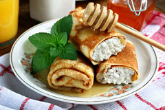 Cottage cheese crepes. Rolled pancakes with cottage cheese close up Stock Images