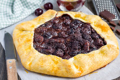 Cottage cheese dough galette with cherries and chocolate, horizontal Royalty Free Stock Images