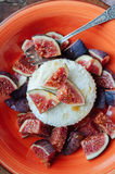 Cottage cheese with figs and honey. Figs with cheese and honey on a ceramic plate Stock Images