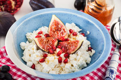 Cottage cheese, figs, pomegranate and honey Stock Photography