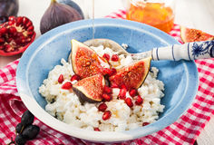 Cottage cheese, figs, pomegranate and honey Royalty Free Stock Photography