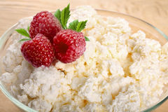 Cottage cheese with fresh berrie bowl wooden board Stock Photography