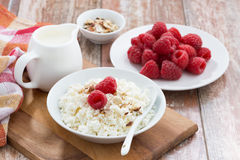 Cottage cheese with fresh raspberry and milk. Horizontal Royalty Free Stock Images