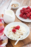 Cottage cheese with fresh raspberry and milk, vertical. Top view Royalty Free Stock Photos